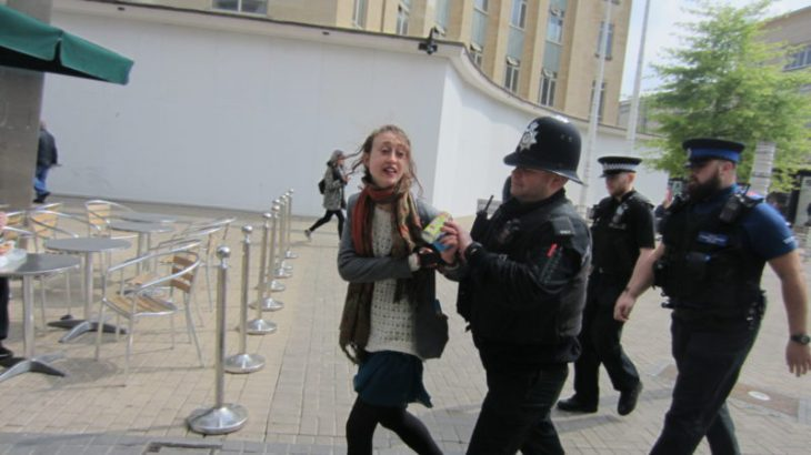 A-third-campaigner-is-led-away-by-police-800x450